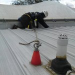 Commercial guttering being cleaned