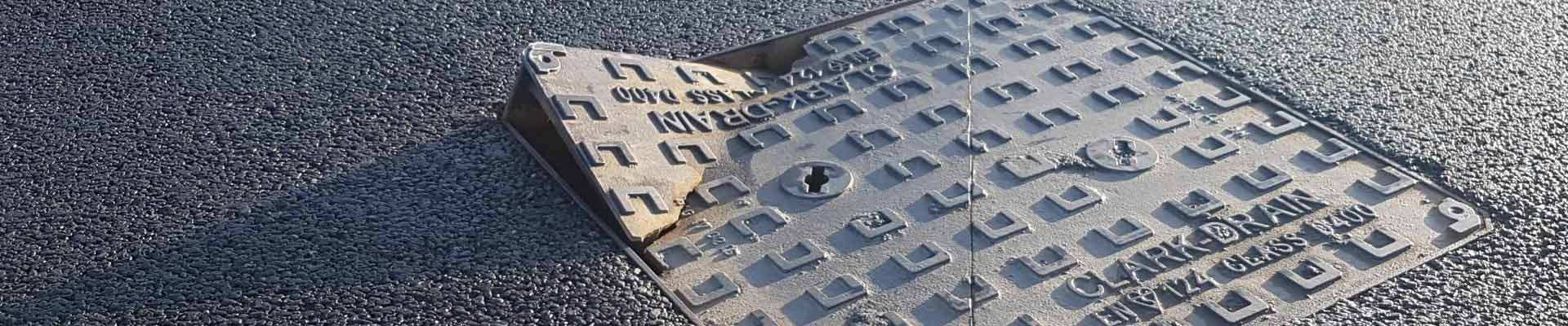 damaged manhole cover